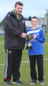 Stephen Gylnn of NTSFL presents the NTSFL Cup to Nenagh AFC under 14 Captain Patrick Murtagh after his Nenagh AFC side were victorious over BT Harps on a 2-0 scoreline last Wednesday
