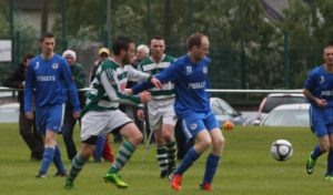 """Thomas """"Ponky"""" Sheppard holds off Nenagh Celtic players as he looks to gain possession for his Nenagh AFC side in their 5-2 victory over local rivals Nenagh Celtic in Brickfields last Sunday in the Ricky Fogarty Cup Final"""